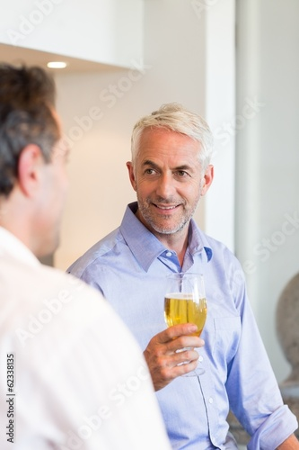 Two business colleagues drinking beer