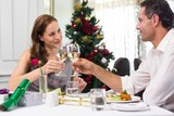 Couple toasting wine glasses in the restaurant