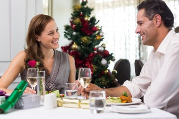 Couple with wine at dining table in restaurant