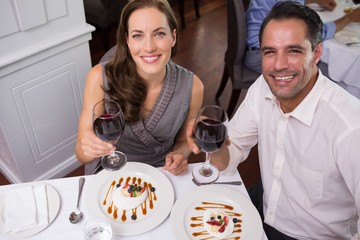 Couple with wine glasses dining in the restaurant