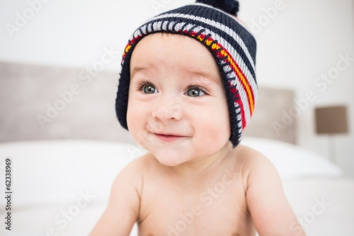 Baby boy wearing knit hat looking away