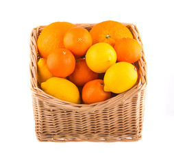 Oranges and lemons in a wooden basket