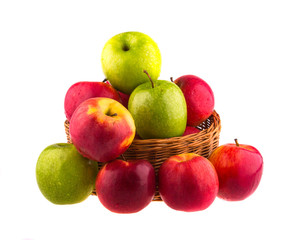 Fresh red and green apples in a wooden basket
