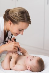 Doctor checking cute baby