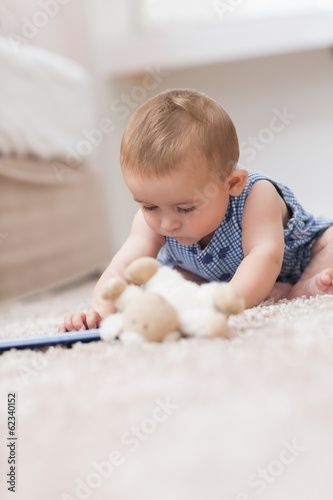 Baby playing with digital tablet
