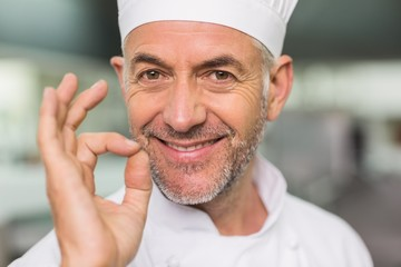 Happy chef looking at the camera making ok sign