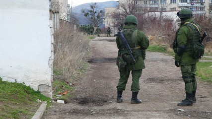 Russian soldiers guarding a naval base in Perevalne, Ukraine