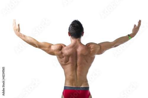 Back of young bodybuilder with arms spread open