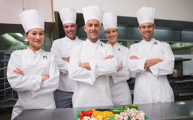 Head chef standing with happy trainees