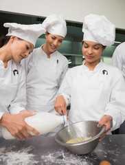 Chefs preparing pastry together