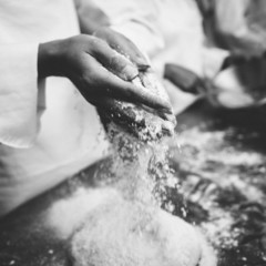Chef preparing dough at counter