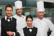 Restaurant team posing together smiling at camera