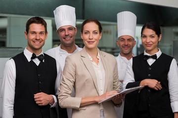 Restaurant team posing together smiling at camera