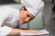 Chef wiping down surface