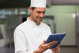 Happy chef using tablet pc