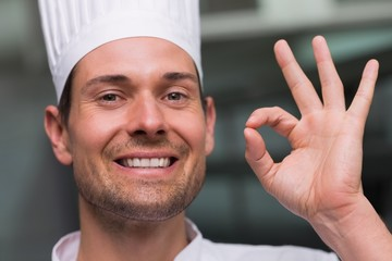 Happy chef making ok sign to camera