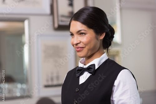 Pretty waitress smiling