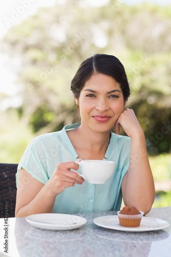 Smiling businesswoman having a coffee