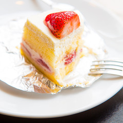 Strawberry cake on a plate with fork