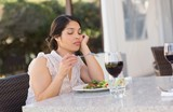 Bored woman eating a salad
