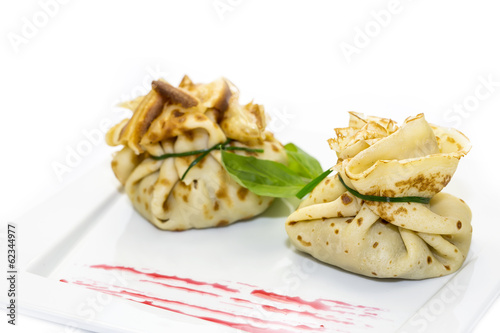 pancakes with meat on a white background in the restaurant