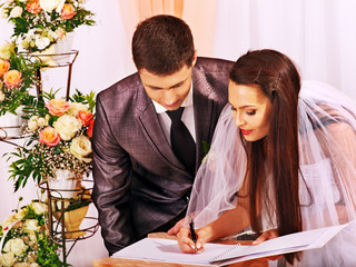 Groom and bride register marriage