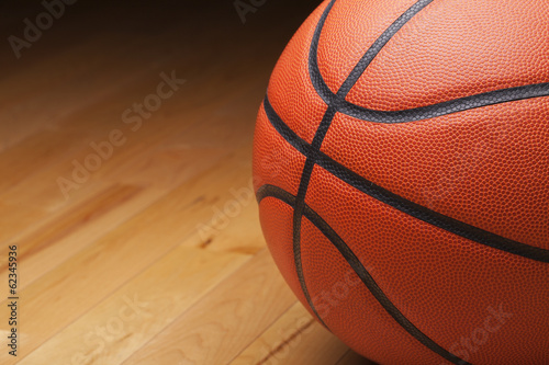 Basketball shot close up on hardwood gym floor