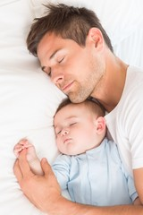 Father and baby son sleeping