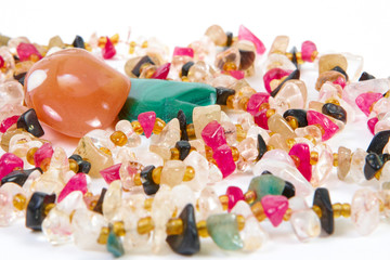 beads of different stones on a white background