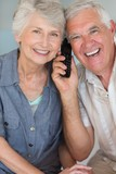 Happy senior couple listening to the phone