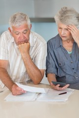 Worried senior couple organising their finances