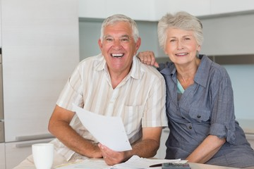 Happy senior couple organising their finances