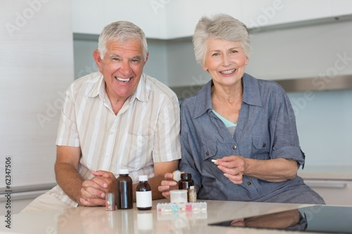 Happy senior couple organising their medicine
