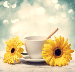 Coffee cup with yellow gerberas
