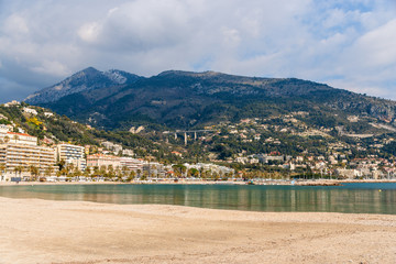 View of Ligurian Alps and Menton city from the Mediterranean Sea