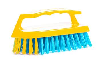 isolated  kitchen scrubbrush with yellow handle