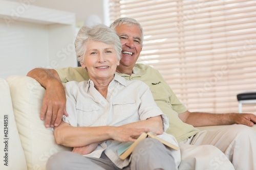 Cheerful senior couple relaxing on the couch together