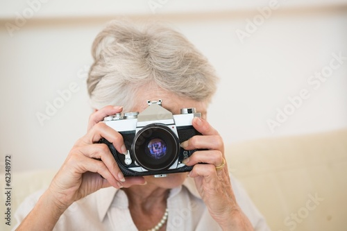 Senior woman taking a photograph