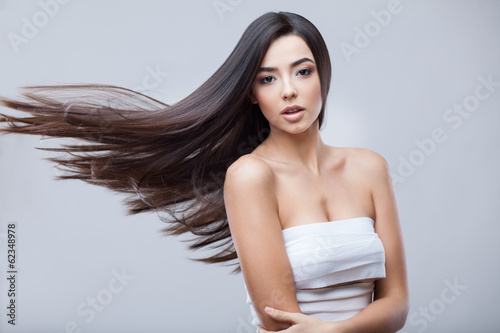 Beautiful Brunette Girl with Healthy Long Hair - 62348978
