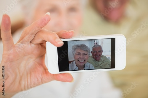 Senior woman taking a selfie with her smartphone