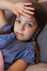 Close-up portrait of a girl resting on couch