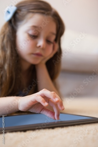 Close-up of a little girl using digital tablet
