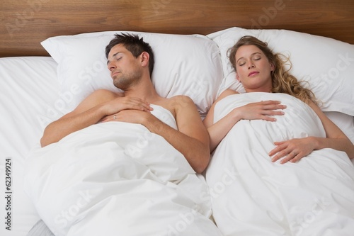 High angle view of a couple sleeping in bed