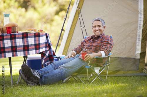 Man Enjoying Camping Holiday In Countryside
