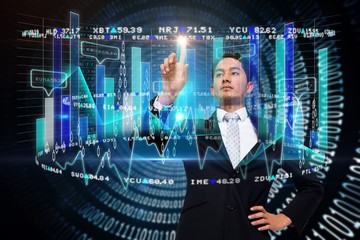 Asian businessman pointing to data interface