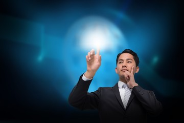 Asian businessman pointing to light