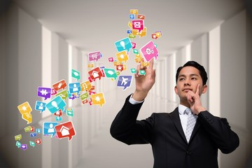 Asian businessman pointing to app icons