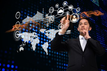 Asian businessman pointing to interface with map and icons