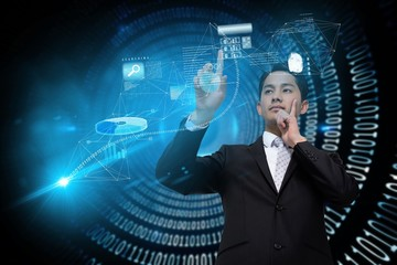 Asian businessman pointing to interface