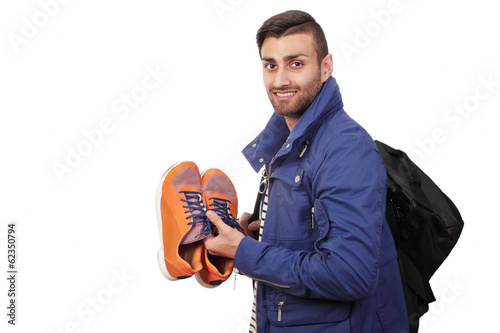 Smiling trekker with gear, portrait with copy space